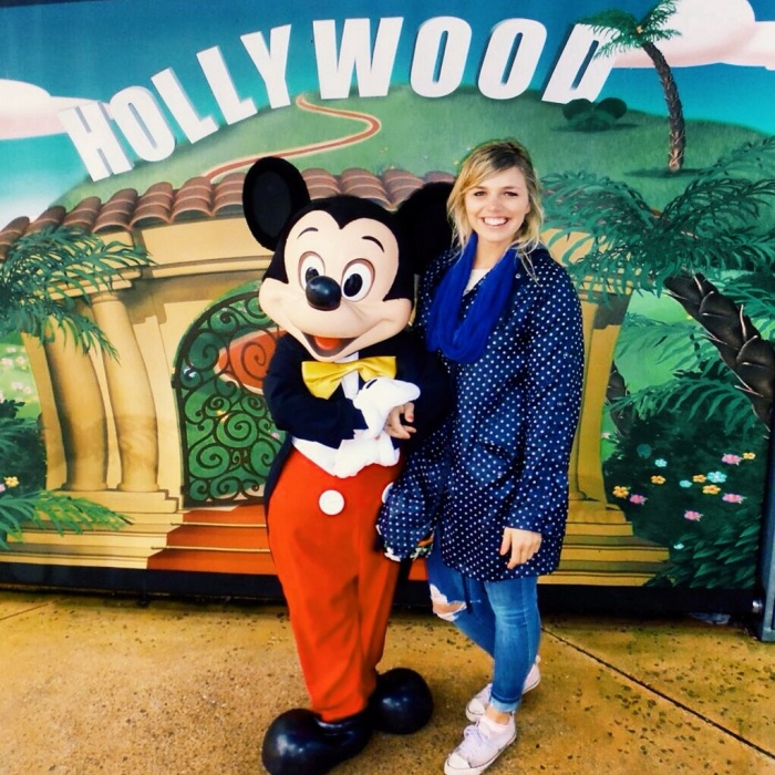Mickey Mouse and myself looking like a drowned rat.