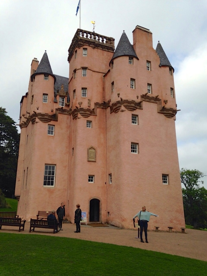 The Disney-esque Craigevar Castle stands pretty in pink.