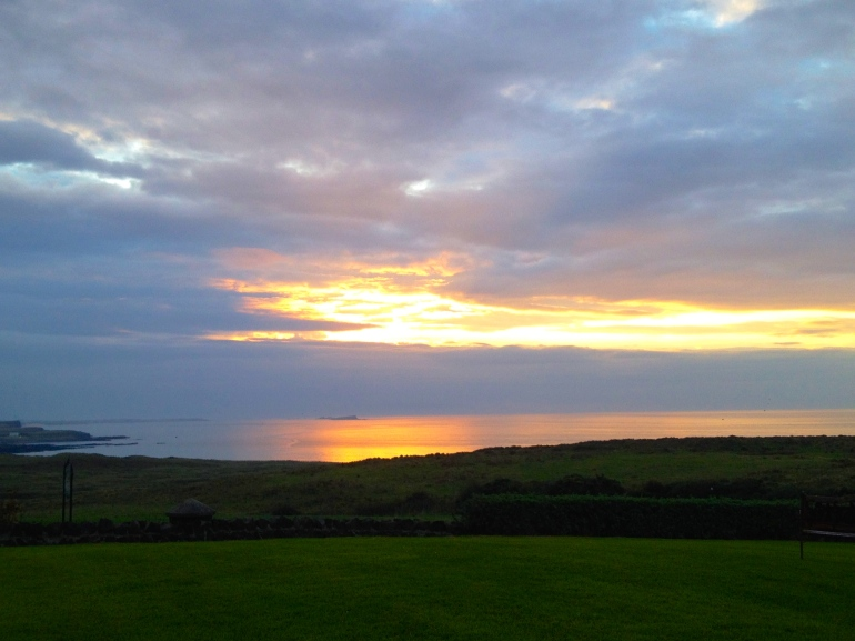 The most remarkable sunset overlooking Bushmills. The owner of Ballylinny Cottages told us it was rare to see the sea so calm and still.
