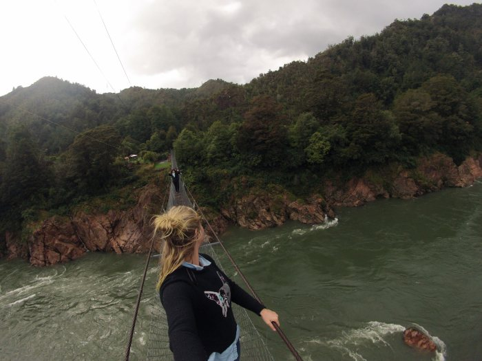 Walking across the Buller Gorge Swing Bridge