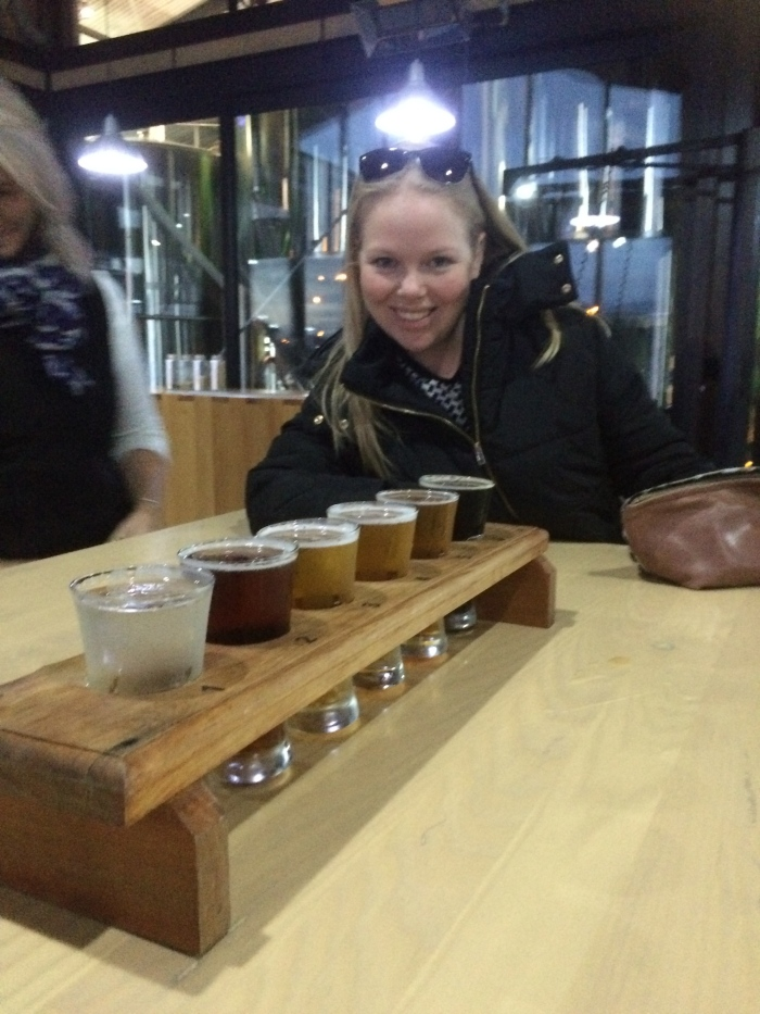S enjoying the tasting tray at the Monteiths Brewery in Greymouth