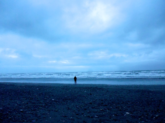 K, the lone figure on the beach at Greymouth